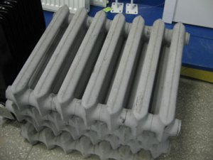 Мощность одной секции чугунного радиатора.